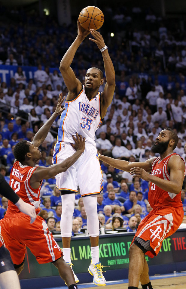 Photo - Oklahoma City's Kevin Durant (35) passes away from Houston's Patrick Beverley (12) and James Harden (13) during Game 2 in the first round of the NBA playoffs between the Oklahoma City Thunder and the Houston Rockets at Chesapeake Energy Arena in Oklahoma City, Wednesday, April 24, 2013. Oklahoma City won, 105-102. Photo by Nate Billings, The Oklahoman