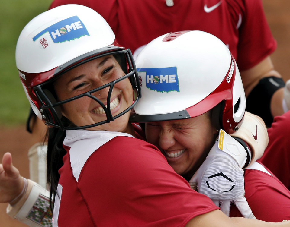 Lauren Chamberlain, left, hugs Shelby Pendley after Pendley's home run in the NCAA Super Regional softball game as the University of Oklahoma (OU) Sooners defeat Texas A&M 8-0 at Marita Hines Field on Saturday, May 25, 2013 in Norman, Okla. to advance to the College World Series.  Photo by Steve Sisney, The Oklahoman