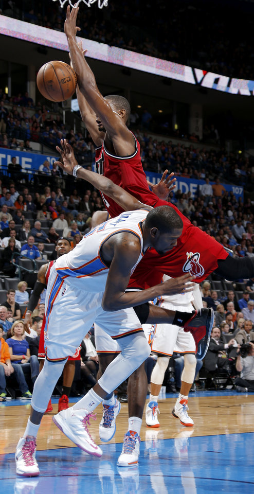 Miami\'s Chris Bosh (1) lands on Oklahoma City\'s Kevin Durant (35) during an NBA basketball game between the Oklahoma City Thunder and the Miami Heat at Chesapeake Energy Arena in Oklahoma City, Thursday, Feb. 15, 2013. Miami won 110-100. Photo by Bryan Terry, The Oklahoman