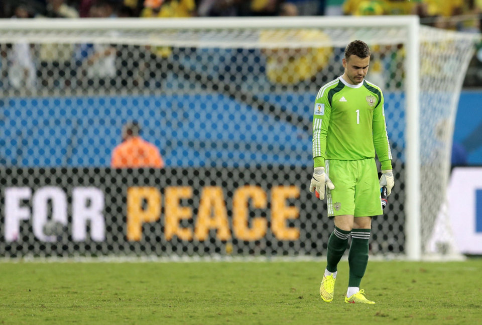 Photo - Russia's goalkeeper Igor Akinfeev walks off the pitch after a 1-1 tie with South Korea during the group H World Cup soccer match between Russia and South Korea at the Arena Pantanal in Cuiaba, Brazil, Tuesday, June 17, 2014.  (AP Photo/Ivan Sekretarev)