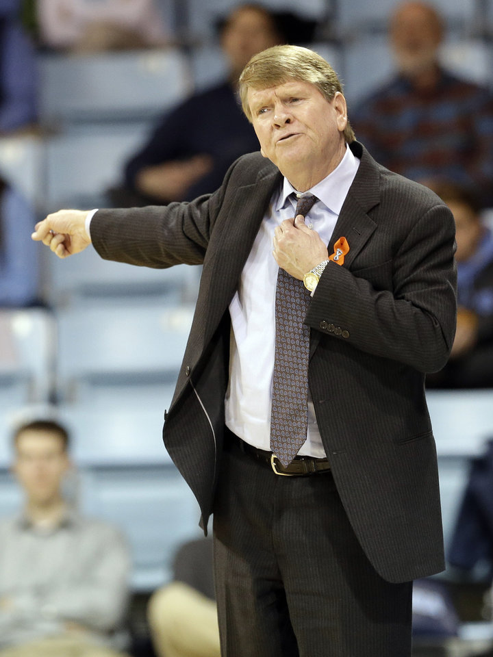 Photo - North Carolina associate coach Andrew Calder directs the team during the first half of an NCAA college basketball game against Clemson in Chapel Hill, N.C., Thursday, Jan. 16, 2014. North Carolina won 78-55. (AP Photo/Gerry Broome)