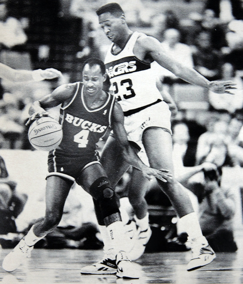 Former OU basketball player Wayman Tisdale. INDIANAPOLIS. Jan. 8 -- WATCHING OUT -- Indiana Pacer Wayman Tisdale, right, moves to avoid the foul as Milwaukee Bucks guard Sidney Moncrief tries to keep control of the ball in early NBA action in Inianapolis Thursday. Indiana defeated Milwaukee 114-108. (AP LaserPhoto) Photo by Michael Conroy 1983. Photo taken 1/8/1988, Photo published 1/9/1988 in The Daily Oklahoman. ORG XMIT: KOD