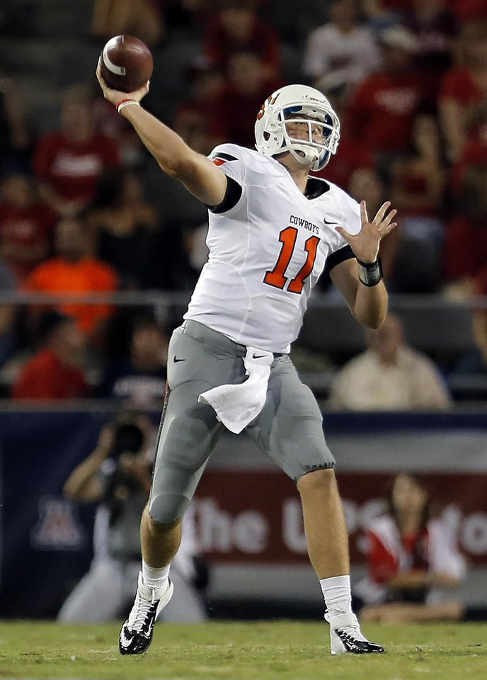 Photo - Oklahoma State's Wes Lunt (11) throws during the college football game between the University  of Arizona and Oklahoma State University at Arizona Stadium in Tucson, Ariz.,  Saturday, Sept. 8, 2012. Photo by Sarah Phipps, The Oklahoman