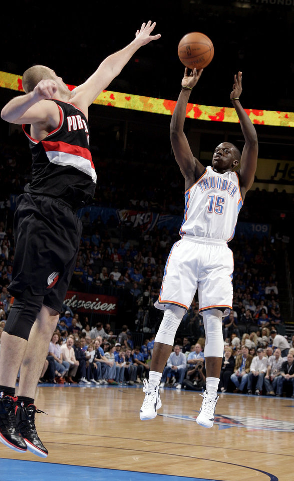 Oklahoma City's Reggie Jackson (15) shoots as Portland 's Joel Przybilla (10) defends during the NBA basketball game between the Oklahoma City Thunder and the Portland Trailblazers at Chesapeake Energy Arena in Oklahoma City, Sunday, March 18, 2012. Photo by Sarah Phipps, The Oklahoman.