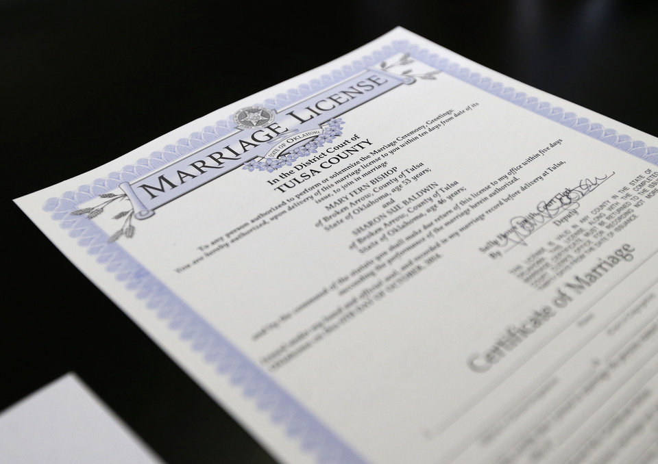 Photo - The marriage license of Sharon Baldwin  and Mary Bishop, two Tulsa women at the center of a gay marriage case that was appealed to the Supreme Court, is seen on Monday, October 6, 2014 at the Tulsa County Courthouse in Tulsa, Okla. MATT BARNARD/Tulsa World