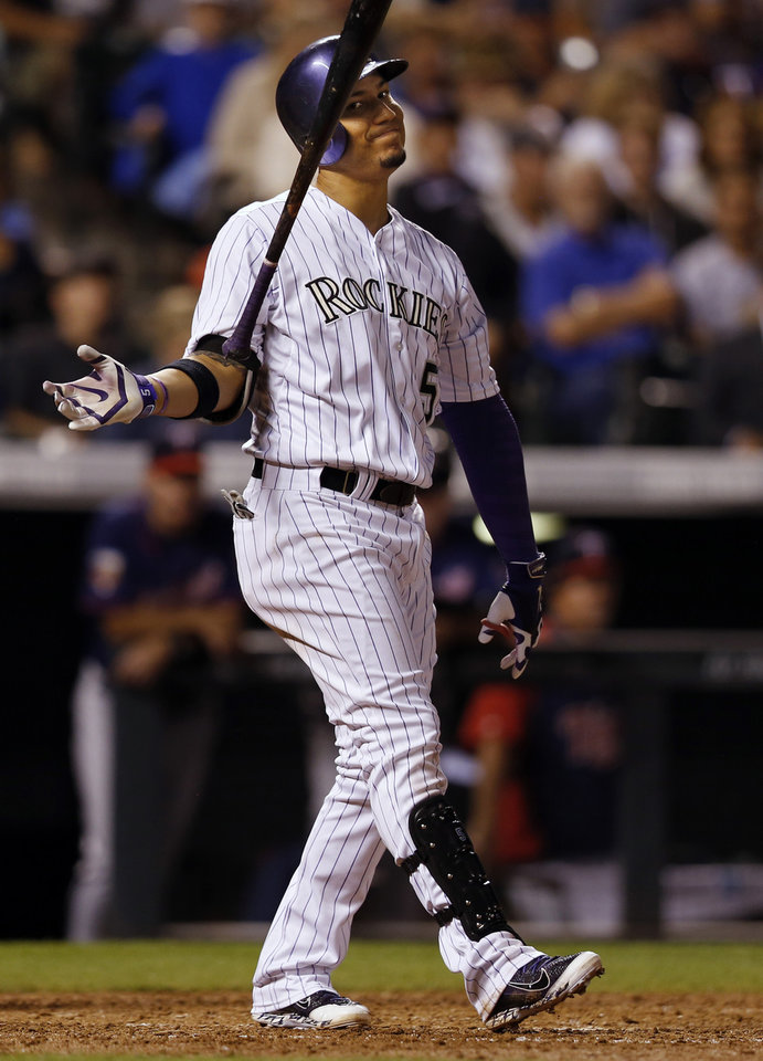 Photo - Colorado Rockies' Carlos Gonzalez reacts to striking out against the Minnesota Twins during the seventh inning of a baseball game on Friday, July 11, 2014, in Denver. (AP Photo/Jack Dempsey)