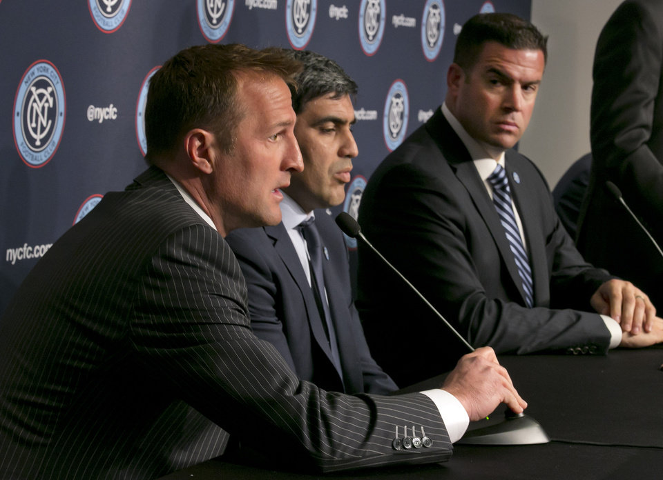 Photo - New York City Football Club soccer head coach Jason Kreis, left, is joined by Director of Football Operations Claudio Reyna, center, and Chief Business Officer Tim Pernetti, as he answers questions at a New York City FC news conference, at New York's Yankee Stadium,  Monday, April 21, 2014. The Yankees announced that Yankee Stadium will serve as the Club's first home and begin play on March 2015. (AP Photo/Richard Drew)