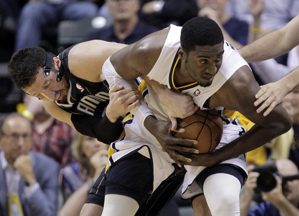 Photo -   Orlando Magic forward Hedo Turkoglu, left, and Indiana Pacers center Roy Hibbert tussle for control of the ball in the first half of Game 5 of an NBA basketball first-round playoff series, in Indianapolis on Tuesday, May 8, 2012. (AP Photo/Michael Conroy)