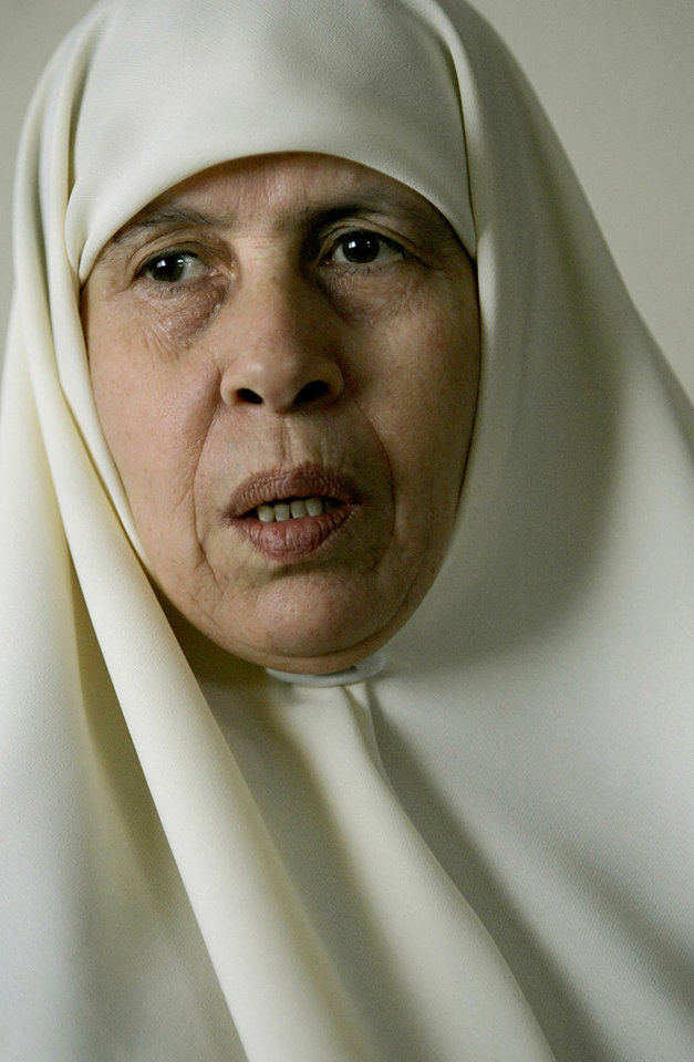 "FILE -- In this Thursday, Feb. 16, 2006 file photo, Mariam Farhat is seen in her house in Gaza City.  Farhat, 64, died in Gaza City, Sunday, March 17, 2013. Farhat, who known as the ""mother of martyrs,"" lost three of her six sons, all three Hamas militants, in fighting with Israel. (AP Photo/Alexander Zemlianichenko, File)"