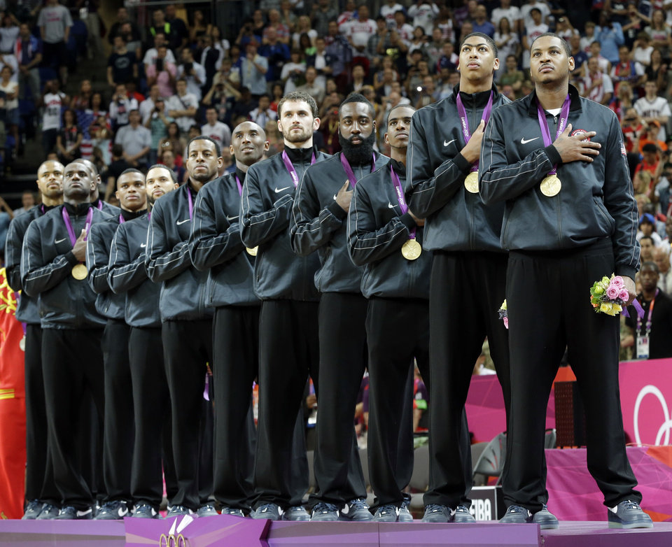 Members of USA's men's basketball team listen to the national anthem after winning the gold medal at the 2012 Summer Olympics, Sunday, Aug. 12, 2012, in London. (AP Photo/Eric Gay)