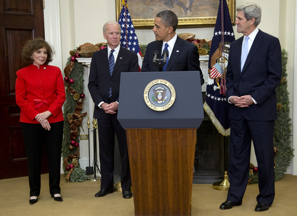 Photo - Vice President Joe Biden looks on as President Barack Obama looks to Teresa Heinz Kerry, left, as he announces his nomination of her husband Sen. John Kerry, D-Mass., right, as next secretary of state in the Roosevelt Room of the White House, Friday, Dec. 21, 2012, in Washington. (AP Photo/Carolyn Kaster)