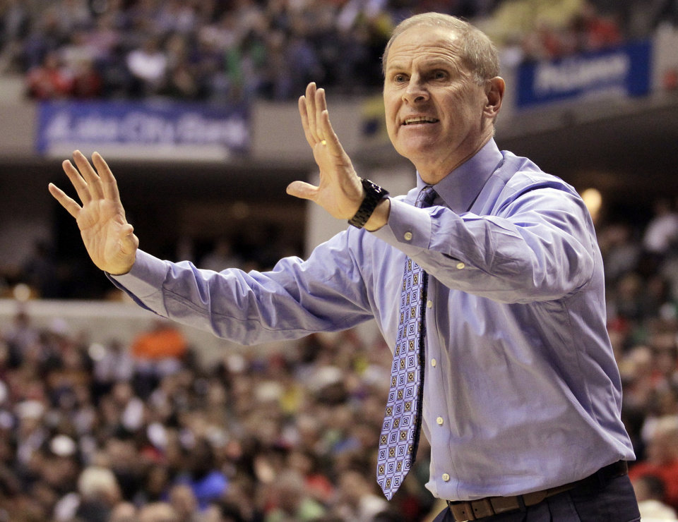 Photo -   Michigan head coach John Beilein directs his team in the first half of an NCAA college basketball game Ohio State in the semifinals of the Big Ten Conference tournament in Indianapolis, Saturday, March 10, 2012. (AP Photo/Michael Conroy)