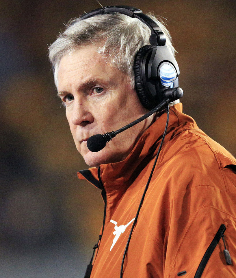 FILE - In this Nov. 9, 2013, file photo, Texas coach Mack Brown watches his team during the second quarter of an NCAA college football game against West Virginia in Morgantown, W.Va. Brown's attorney says the Texas coach has not resigned, denying a report on Tuesday, Dec. 10, 2013, that Brown was ready to step down after 16 seasons with the Longhorns.  (AP Photo/Christopher Jackson, File)
