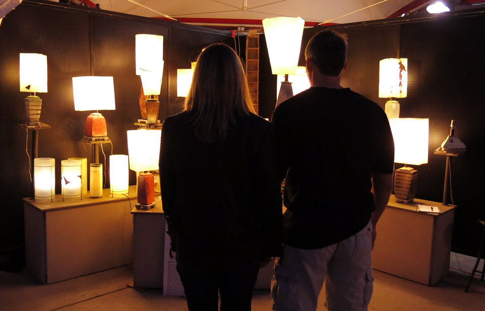 A couple stops to look at hand made lamps by William Richards of Underwood, Washington during the Festival of the Arts, Saturday evening, April 29, 2013.  Photo by Doug Hoke, The Oklahoman