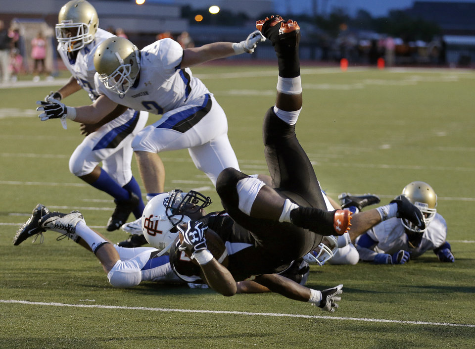 Photo - Putnam City's JaVone Knox scores a touchdown during the high school football game between Putnam City and Choctaw at Putnam City High School in Oklahoma City, Thursday, Sept. 19, 2013. Photo by Sarah Phipps, The Oklahoman