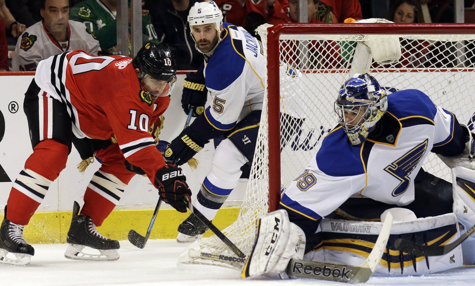 Photo - St. Louis Blues goalie Ryan Miller (39) blocks a shot by Chicago Blackhawks' Patrick Sharp (10) during the second period in Game 4 of a first-round NHL hockey playoff series in Chicago, Wednesday, April 23, 2014. (AP Photo/Nam Y. Huh)