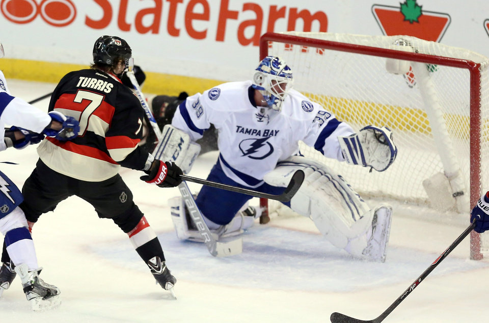 Photo - Ottawa Senators' Kyle Turris (7) scores past Tampa Bay Lighting goaltender Anders Lindback during the second period of an NHL hockey game, Thursday, Jan. 30, 2014 in Ottawa, Ontario. (AP Photo/The Canadian Press, Fred Chartrand)