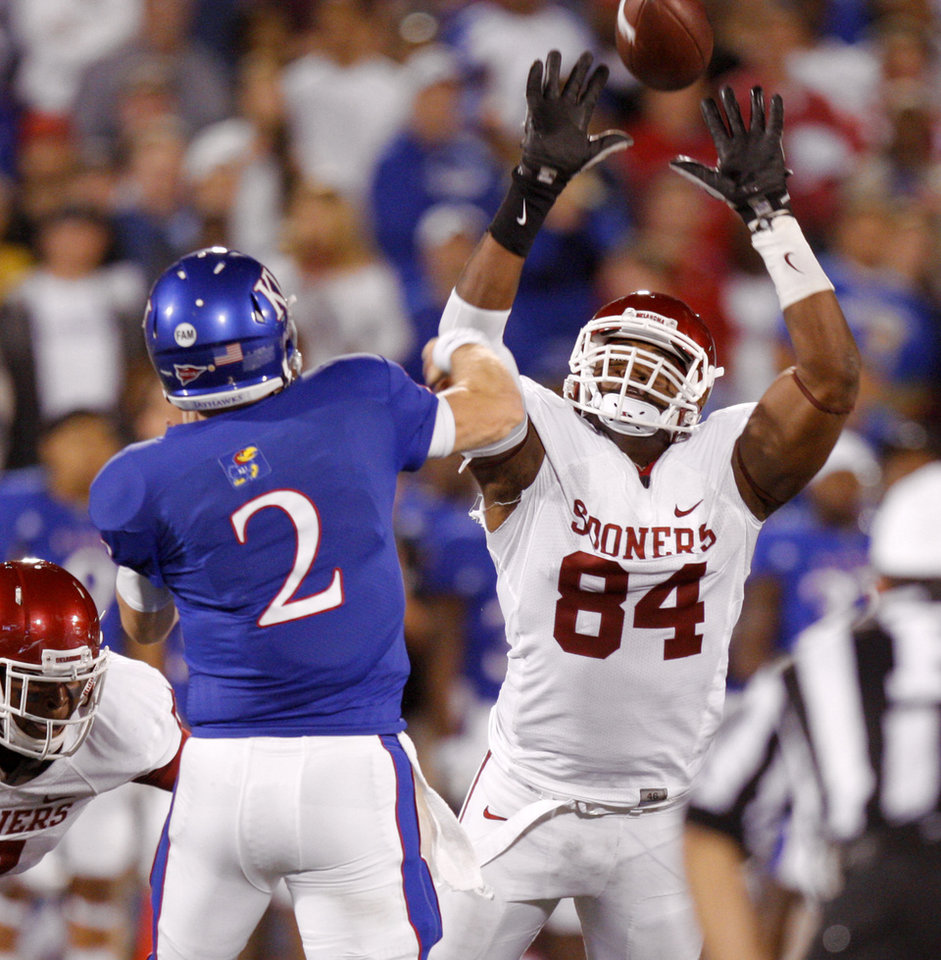 Oklahoma\'s Frank Alexander (84) pressures Kansas\' Jordan Webb (2)during the college football game between the University of Oklahoma Sooners (OU) and the University of Kansas Jayhawks (KU) at Memorial Stadium in Lawrence, Kansas, Saturday, Oct. 15, 2011. Photo by Bryan Terry, The Oklahoman