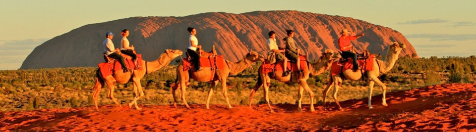Photo -  A group makes the early morning trek to see the sunrise over Ayers Rock in Australia's Outback. Photo courtesy of Steve Murray.