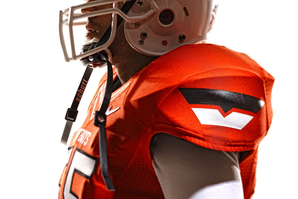 Oklahoma State\'s new football uniforms. Pictured here are the orange jersey and the white helmet. PHOTO PROVIDED