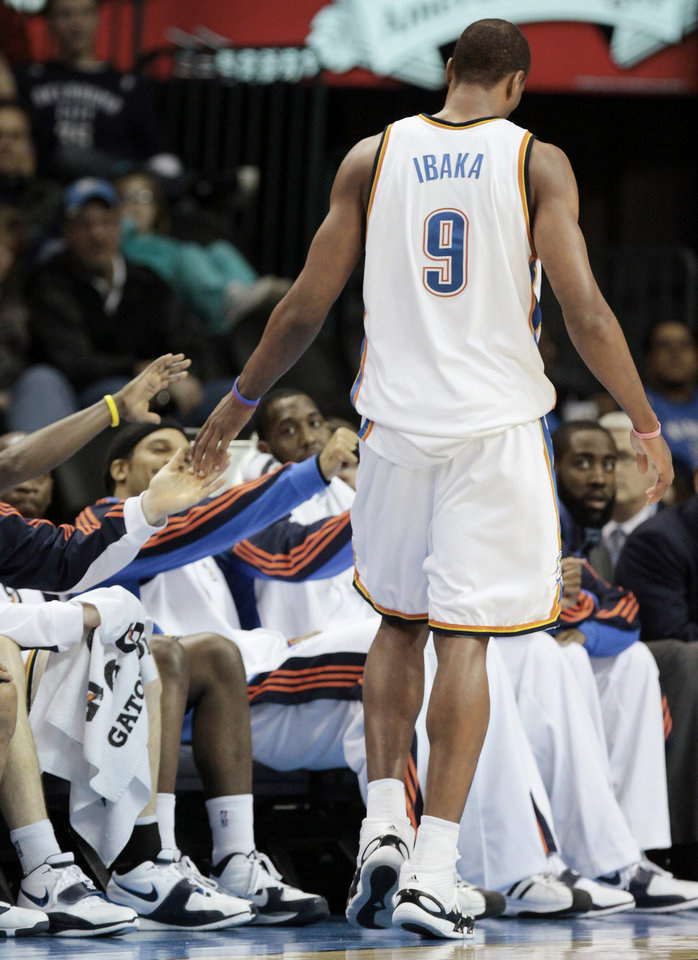 Photo - Serge Ibaka feels the love from his teammates.  Photo by Doug Hoke, The Oklahoman