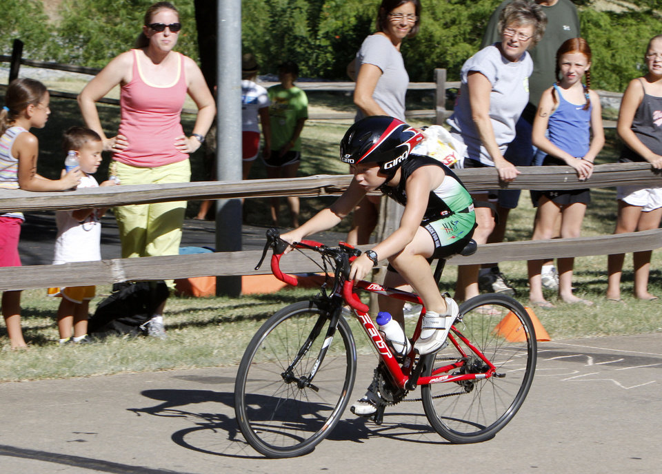 11 year old Cooper Burlison competes in the bicycling leg of a youth triathlon hosted by the Edmond YMCA at Hafer Park and Pelican Bay in Edmond, OK, Saturday, July 21, 2012, By Paul Hellstern, The Oklahoman