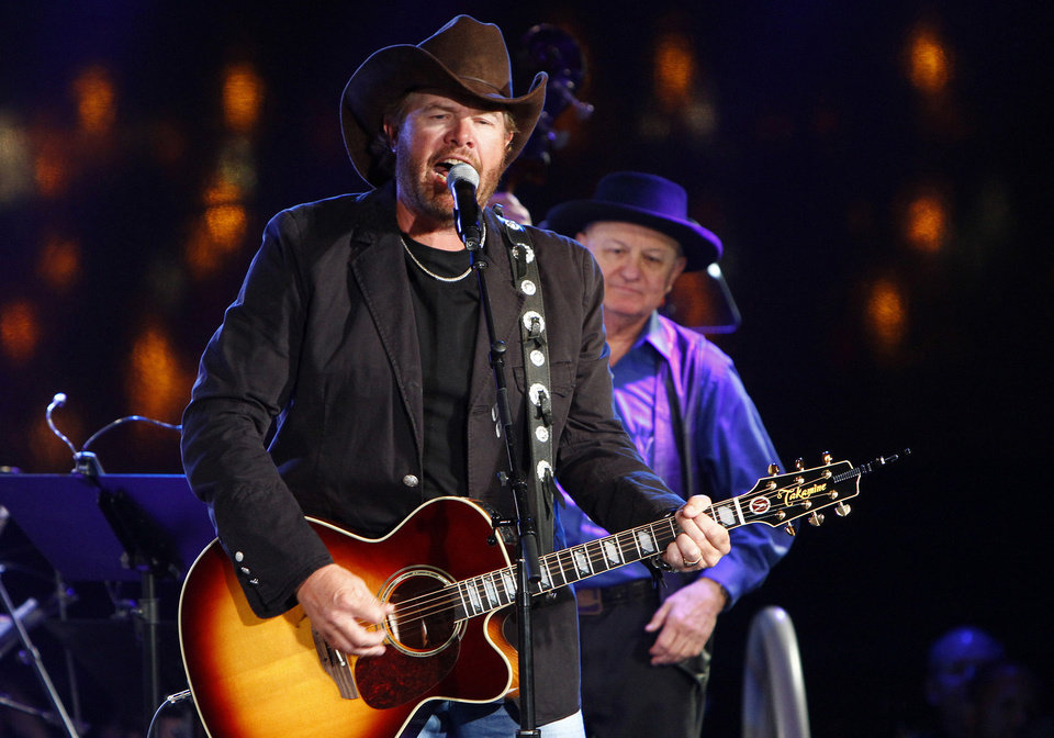 In this Oct. 30, 2012, file photo Toby Keith performs at the 60th Annual BMI Country Awards on in Nashville, Tenn. Keith, whose hometown was hit by a massive tornado on Monday, said Tuesday, May 21, 2013, the people of Moore, Okla., are resilient and he has fielded calls about putting together a benefit for tornado victims. (Photo by Wade Payne/Invision/AP, File) Wade Payne - Wade Payne/Invision/AP