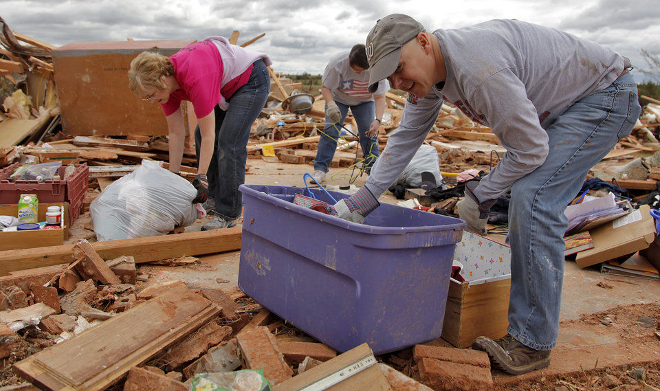 Bonnie Tschetter and Steve Lessman help recover items from the home of Jesse and Miranda Lewis that was destroyed by Tuesday's tornado west of El Reno, Wednesday, May 25, 2011. Photo by Chris Landsberger, The Oklahoman