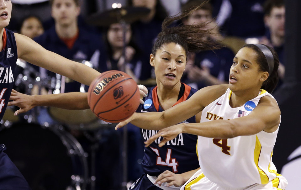 Photo - Gonzaga's Keani Albanez (14) defends Iowa State's Nikki Moody in the first half during a first-round game in the women's NCAA college basketball tournament in Spokane, Wash., Saturday, March 23, 2013. (AP Photo/Elaine Thompson)