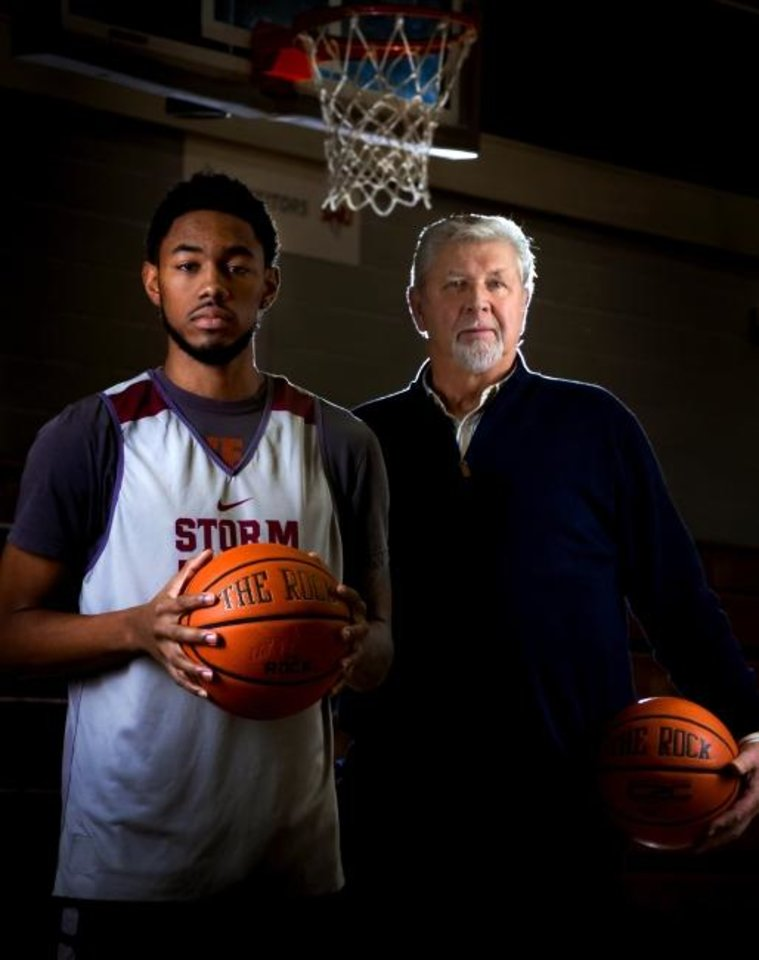 Photo -  Southern Nazarene's Jhonathan Dunn, left, poses with SNU alum Jeff Jantz. Dunn needs seven points to break Jantz's school scoring record of 2,104 points. [Chris Landsberger/The Oklahoman]