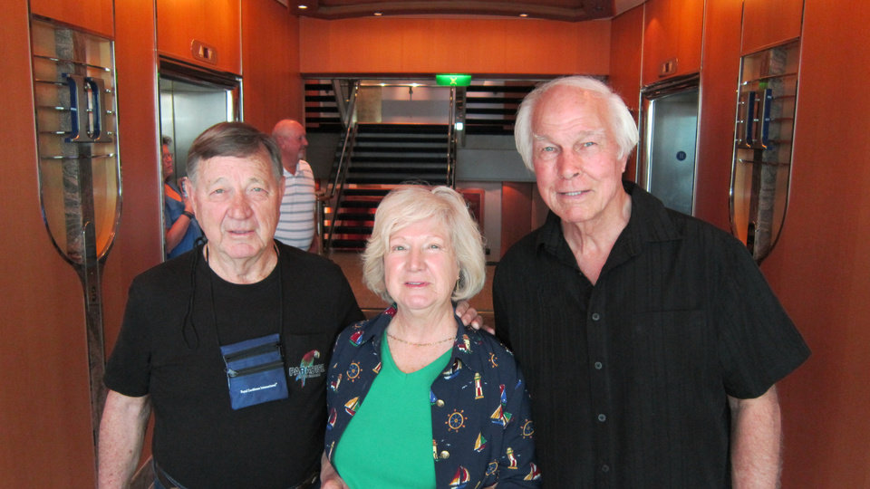 Photo -  Oklahoma residents Wes McFarland, right, with wife Jean, and her brother Joe Harris, left, aboard Royal Caribbean's Navigator of the Seas.   Picasa -  Richard Darnell