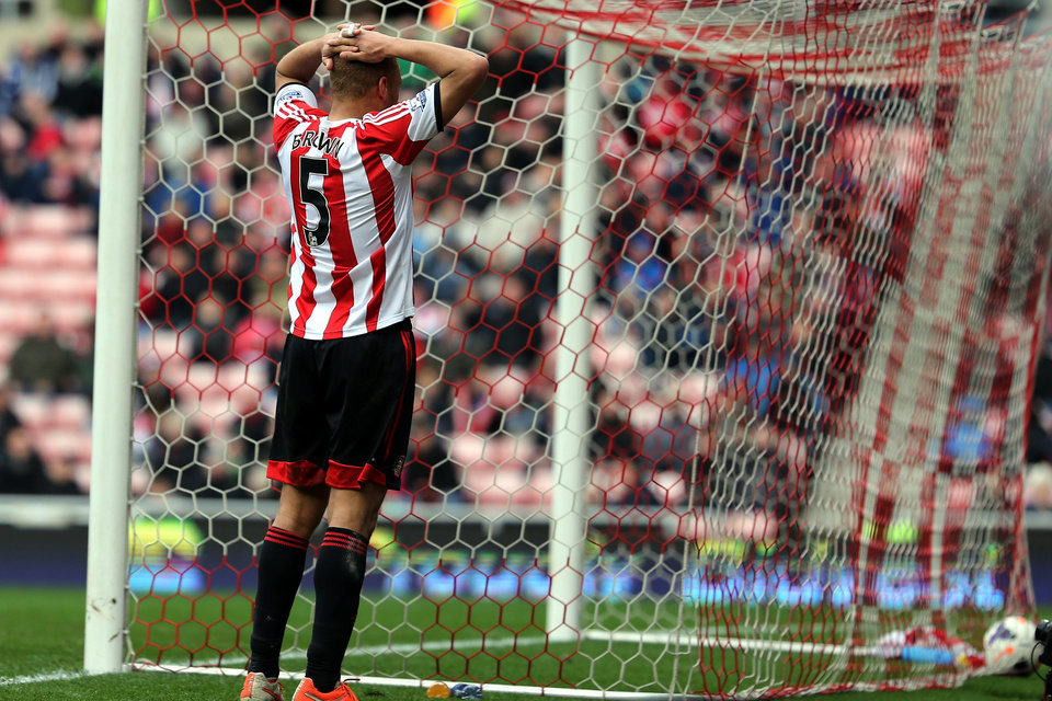 Photo - Sunderland's Wes Brown stands dejected after scoring a own goal during their English Premier League soccer match against Everton at the Stadium of Light, Sunderland, England, Saturday, April 12, 2014. (AP Photo/Scott Heppell)