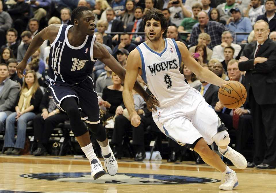 Photo - Oklahoma City Thunder's Reggie Jackson (15) defends against Minnesota Timberwolves' Ricky Rubio (9), of Spain, during the first quarter of an NBA basketball game at the Target Center on Thursday, Dec. 20, 2012, in Minneapolis. (AP Photo/Hannah Foslien)