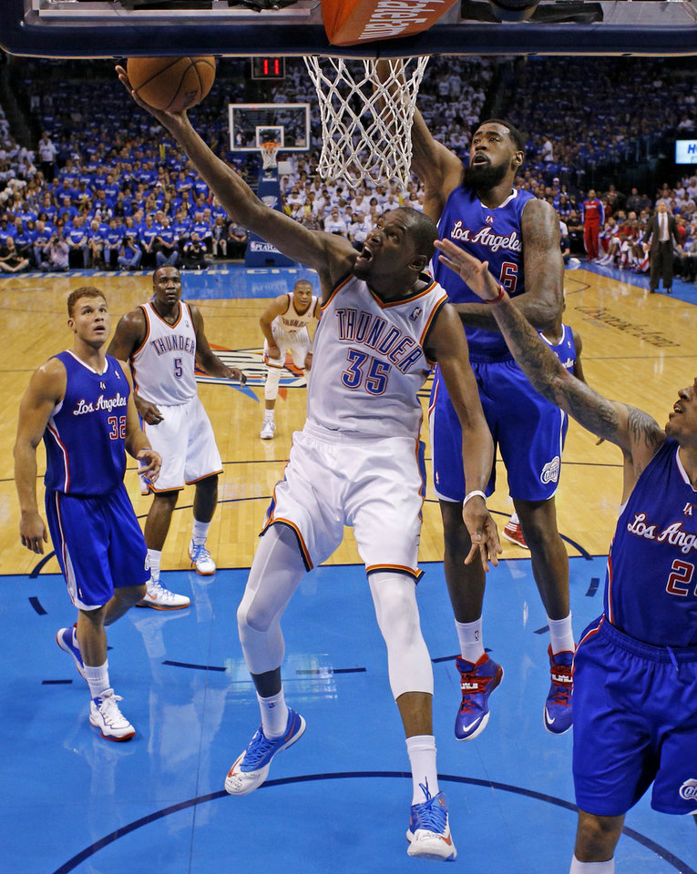 Photo - Oklahoma City's Kevin Durant (35) goes past Los Angeles' DeAndre Jordan (6) during Game 2 of the Western Conference semifinals in the NBA playoffs between the Oklahoma City Thunder and the Los Angeles Clippers at Chesapeake Energy Arena in Oklahoma City, Wednesday, May 7, 2014. Photo by Bryan Terry, The Oklahoman