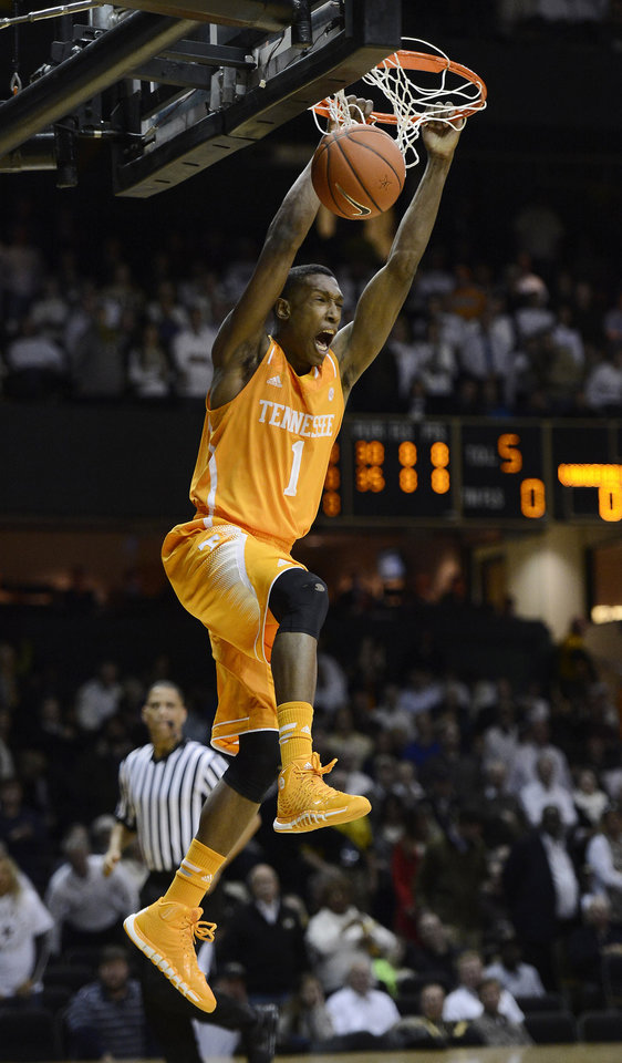 Photo - Tennessee guard Josh Richardson (1) opens the game with a break-a-way dunk in the first half of an NCAA college basketball game against Vanderbilt, Wednesday, Feb. 5, 2014, in Nashville, Tenn. (AP Photo/Mark Zaleski)