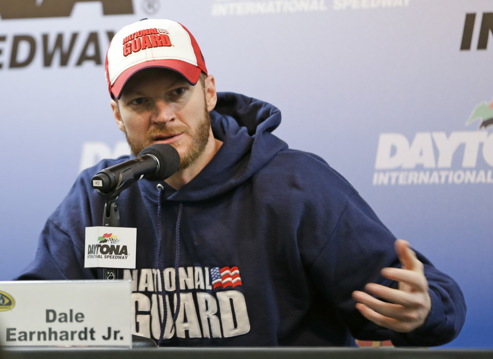 Photo - NASCAR driver Dale Earnhardt Jr. answers questions during a news conference at Sprint Cup auto racing testing at Daytona International Speedway in Daytona Beach, Fla., Friday, Jan. 10, 2014.(AP Photo/John Raoux)