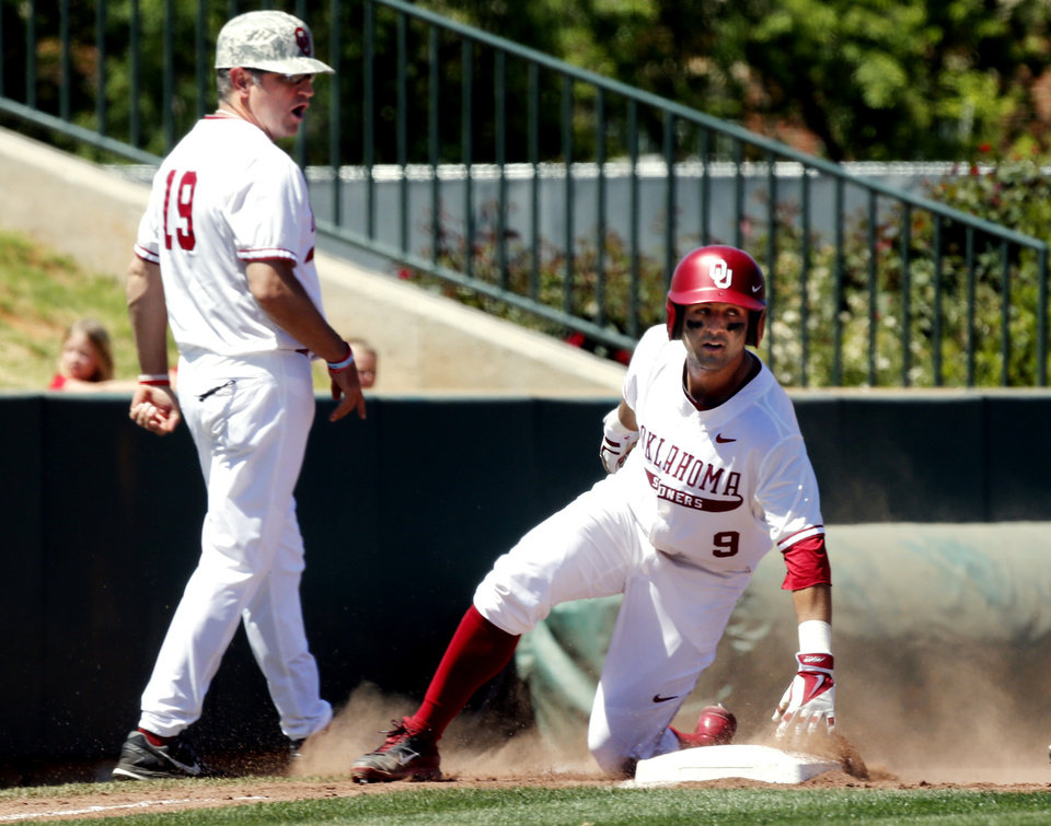 Photo - Oklahoma's Anthony Hermelyn (9) is safe at third on a triple as the University of Oklahoma Sooner (OU) baseball team plays the Baylor Bears in college baeball at L. Dale Mitchell Park on May 3, 2014 in Norman, Okla. Photo by Steve Sisney, The Oklahoman