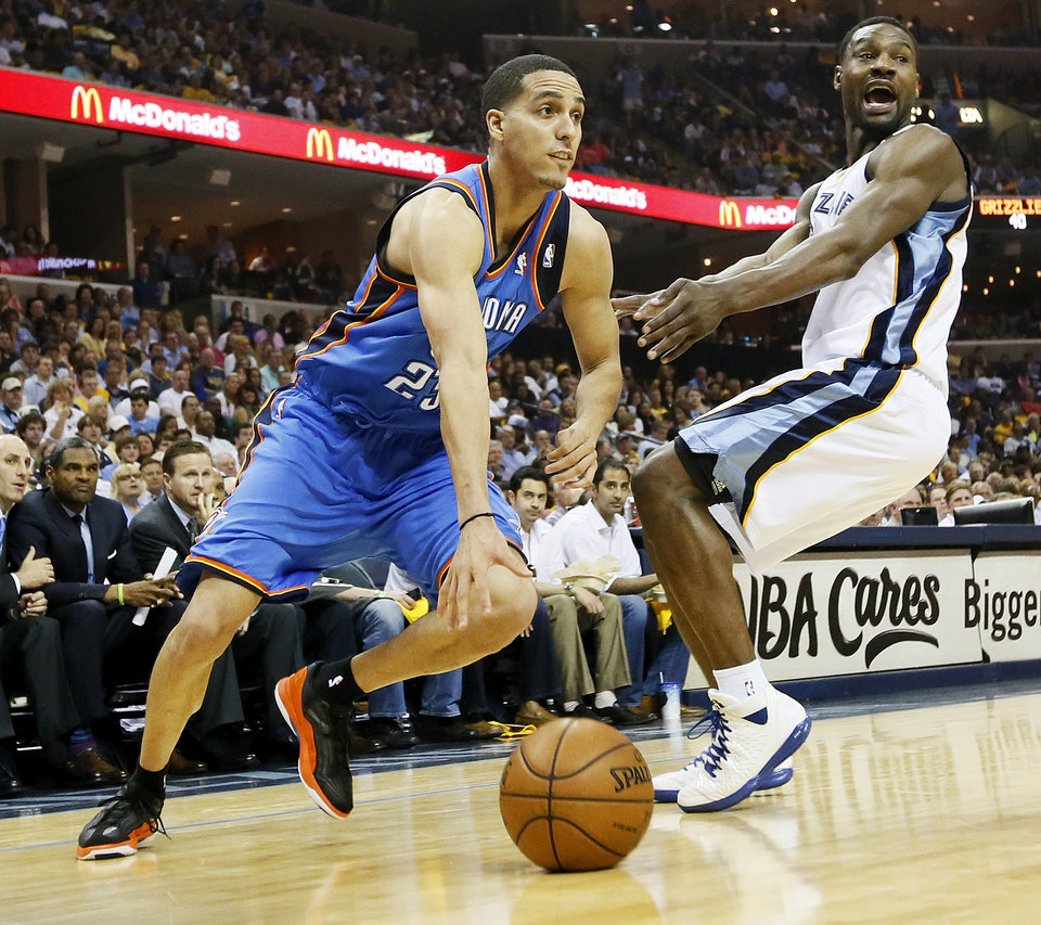 Photo - Oklahoma City's Kevin Martin (23) drives against Memphis' Tony Allen (9) during Game 3 in the second round of the NBA basketball playoffs between the Oklahoma City Thunder and Memphis Grizzles at the FedExForum in Memphis, Tenn., Saturday, May 11, 2013. Photo by Nate Billings, The Oklahoman