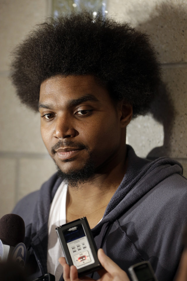 Philadelphia 76ers' Andrew Bynum speaks to members of the media at the team's NBA training facility Friday, March 1, 2013, in Philadelphia. (AP Photo/Matt Rourke)