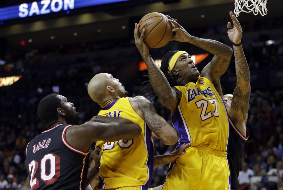 Photo - Los Angeles Lakers forward Jordan Hill (27) goes to the basket against the Miami Heat during the third quarter of an NBA basketball game in Miami, Thursday, Jan. 23, 2014. The Heat won 109-102. (AP Photo/Alan Diaz)