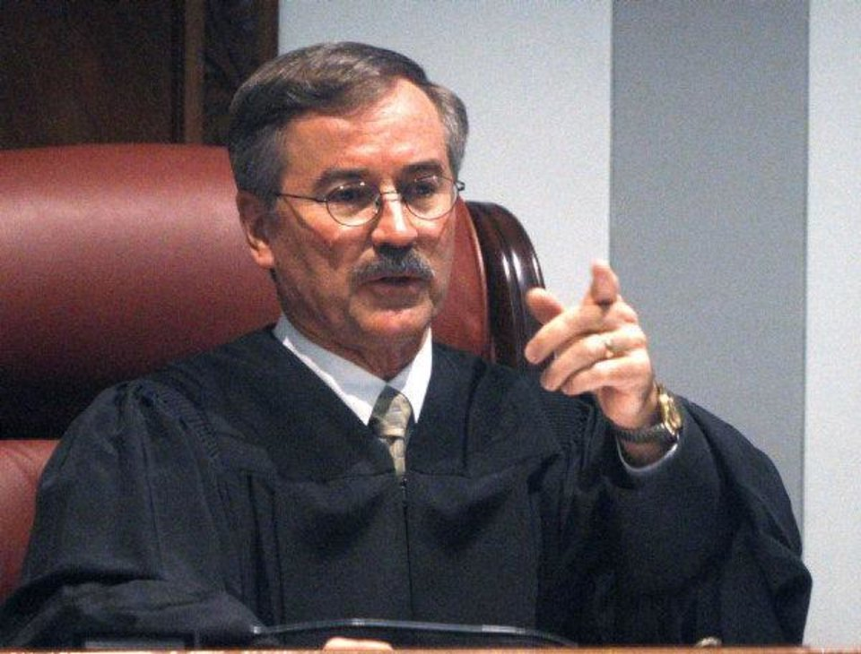 Oklahoma County District Judge Ray C. Elliott gestures Tuesday from the bench. <strong>Sue Ogrocki - AP</strong>