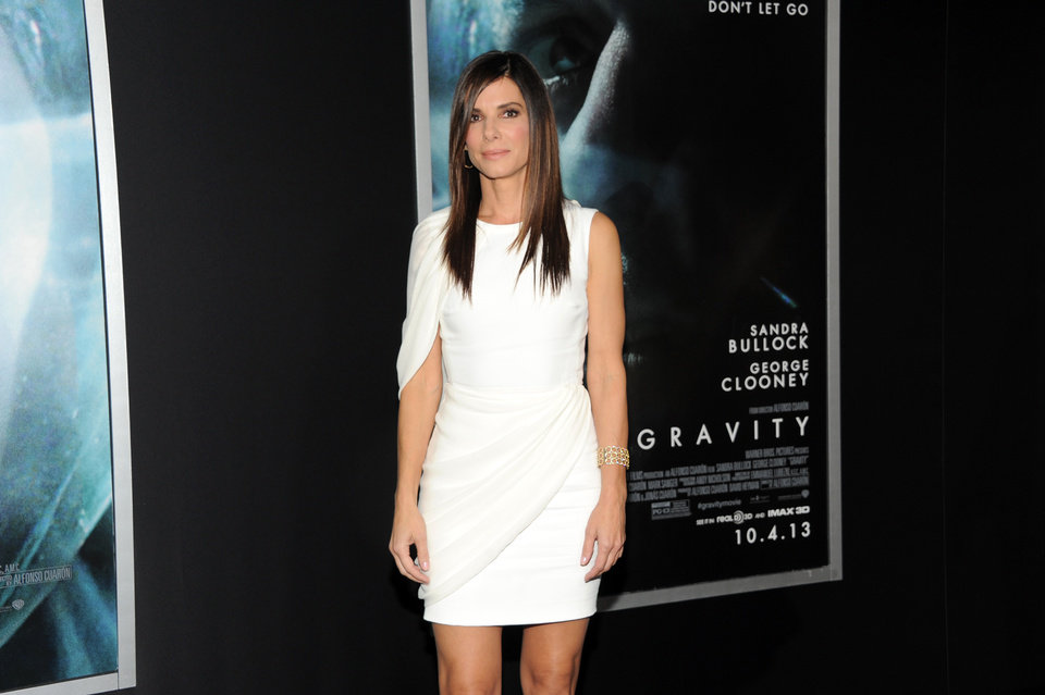 "Photo - Actress Sandra Bullock attends the premiere of ""Gravity"" at the AMC Lincoln Square Theaters on Tuesday, Oct. 1, 2013, in New York. (Photo by Evan Agostini/Invision/AP) ORG XMIT: NYEA108"