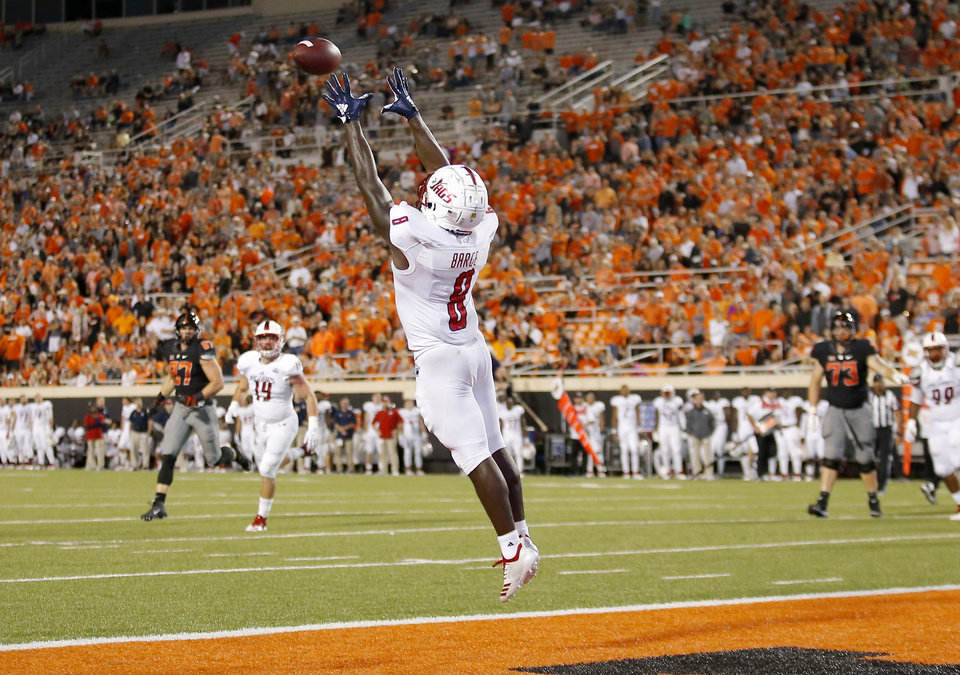 Photo - South Alabama's Bull Barge (8) makes an interception in the third quarter during a college football game between Oklahoma State (OSU) and South Alabama at Boone Pickens Stadium in Stillwater, Okla., Saturday, Sept. 8, 2018. Photo by Sarah Phipps, The Oklahoman