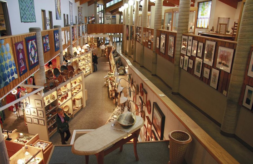 Photo - FILE - This undated file photo courtesy of Michael Booher shows the interior of the Folk Art Center in Asheville, N.C. The Folk Art Center features galleries and a shop with works by southern Appalachian artists.   (AP Photo/Michael Booher)