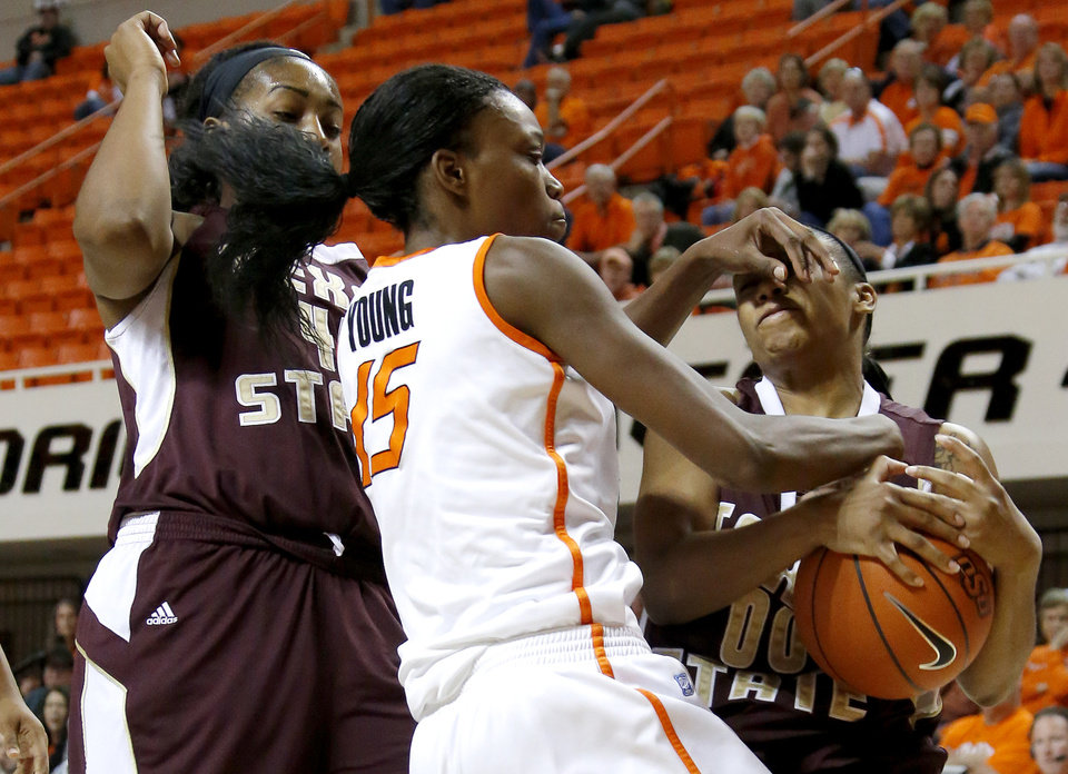 Oklahoma State\'s Toni Young (15) fights for control of the ball between Texas State\'s Ashley Ezeh, at left, and Kaylan Martin during a women\'s college basketball game between Oklahoma State University and Texas State at Gallagher-Iba Arena in Stillwater, Okla., Wednesday, Nov. 28, 2012. Photo by Bryan Terry, The Oklahoman