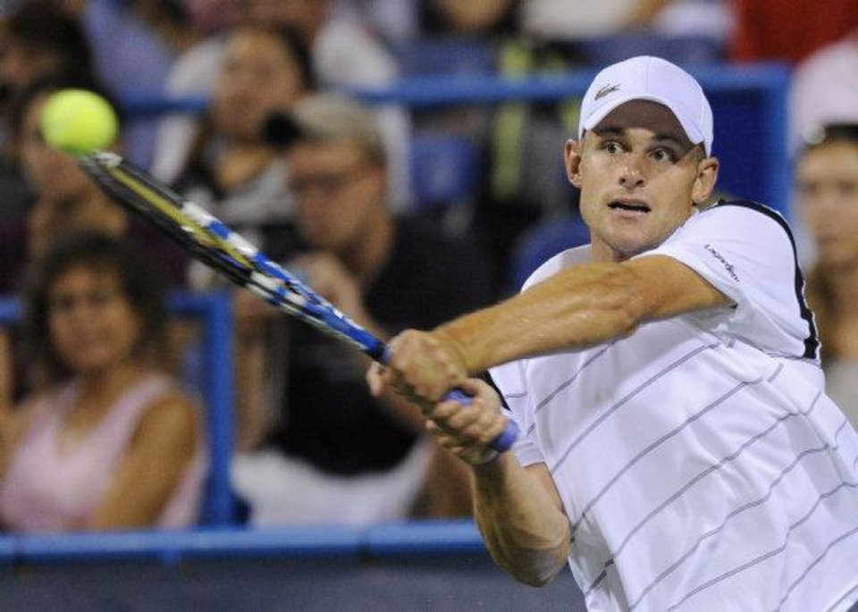 Andy Roddick, of the United States, returns the ball against Grega Zemlja, of Slovenia, during a tennis match at the Legg Mason Tennis Classic, Tuesday, Aug. 3, 2010, in Washington. (AP Photo/Nick Wass) <strong>Nick Wass</strong>