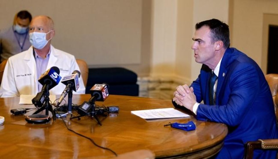 Photo -  Governor Kevin Stitt and Commissioner of Health Lance Frye answer questions regarding COVID-19 during a press conference at the Oklahoma state Capitol in Oklahoma City on Thursday.  [Chris Landsberger/The Oklahoman]