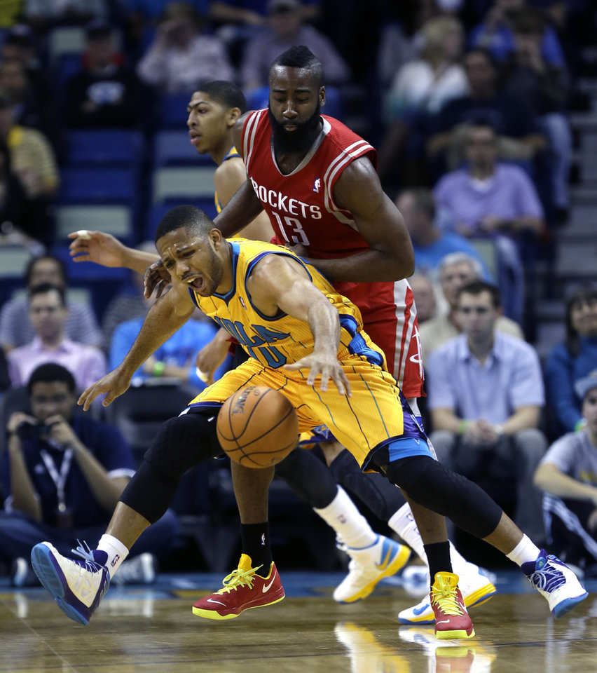 Photo - New Orleans Hornets guard Eric Gordon (10) reacts as he is fouled by Houston Rockets guard James Harden (13) in the first half of an NBA basketball game in New Orleans, Friday, Jan. 25, 2013. (AP Photo/Gerald Herbert)