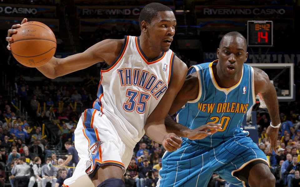 Oklahoma City's Kevin Durant (35) drives past New Orleans' Quincy Pondexter (20) during the NBA basketball game between the Oklahoma City Thunder and the New Orleans Hornets, Wednesday, Feb. 2, 2011 at the Oklahoma City Arena. Photo by Bryan Terry, The Oklahoman
