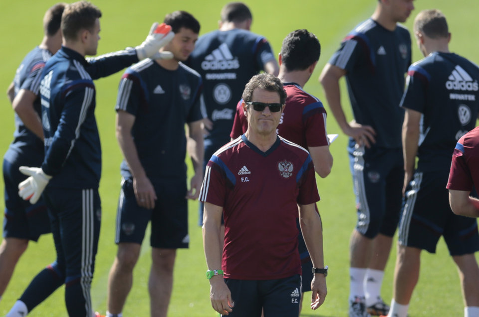 Photo - Fabio Capello, Italian coach of Russian national soccer team, walks during a training session in Itu, Brazil, on Tuesday, June 24, 2014. Russia plays in group H of the 2014 soccer World Cup. (AP Photo/Ivan Sekretarev)